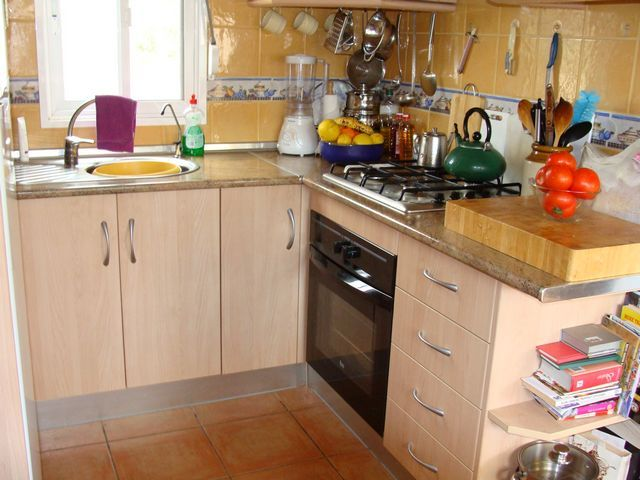 Fully fitted kitchen with a good range of wall and base units and white goods