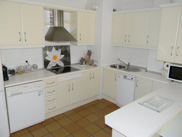 Modern fully fitted American style kitchen with a wide range of wall and base units