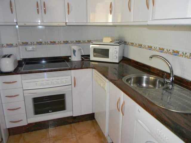Fully fitted kitchen with a good range of wall and base units